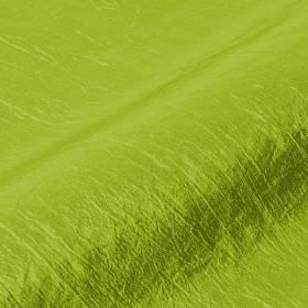 Skip - Green (36) - Vibrant fabric made from a lime green coloured blend of polyamide and polyester, featuring a few slightly raised threads