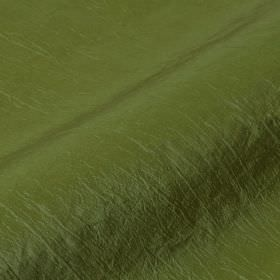 Skip - Green (40) - A few slightly raised threads running through leaf green coloured polyamide amd polyester blend fabric