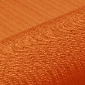 Lavina - Orange (20) - Burnt orange coloured fabric made from a combination of polyester and Trevira CS