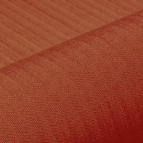 Lavina - Brown Red (21) - Fabric made from an unpatterned blend of polyester and Trevira CS in a deep brick red colour