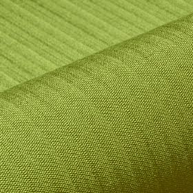 Lavina - Green (29) - Fabric made with a few subtle lines running across a grass green coloured blend of polyester and Trevira CS