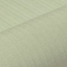 Lavina - Green (33) - Subtle lines running across a light seafoam coloured polyester and Trevira CS blend fabric