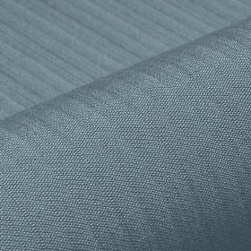 Lavina - Blue (37) - Dusky blue coloured fabric blended from polyester and Trevira CS, featuring a regular, very subtle line pattern