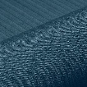 Lavina - Blue (38) - Fabric made with a few subtle lines, from a blend of deep marine blue coloured polyester and Trevira CS