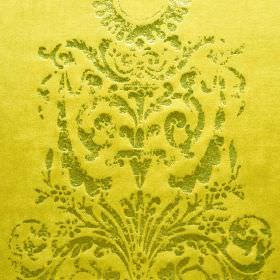 Alma - Gold (1) - Ornate grass green coloured patterns and swirls printed patchily on bright yellow cotton, polyester and viscose blend fabric