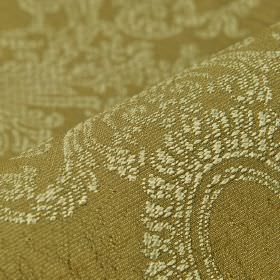Tournelle - Brown (4) - Polyester and viscose blend fabric in Army green, behind an ornate design embroidered in a pale green-cream colour
