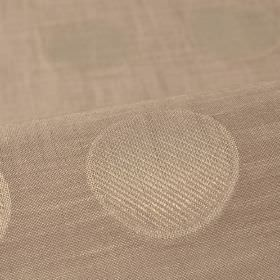 Marstal - Beige - Light brown-cream coloured fabric made from 100% Trevira CS with a design of rows of slightly patterned circles