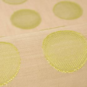 Marstal - Beige Green (8) - 100% Trevira CS fabric in beige, patterned with rows of lime green coloured circles which have a thin stripe pat
