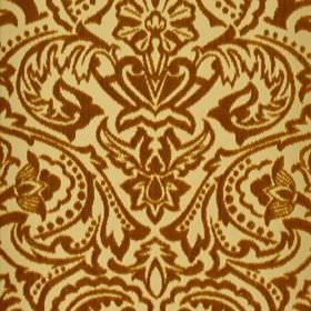 Vertino - Brown (66) - 100% polyester fabric made in orange-brown and light yellow, featuring a large, ornate, striking floral pattern