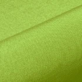 Bandaro - Green (96) - Plain fabric made from 100% Trevira CS in a very bright shade of lime green