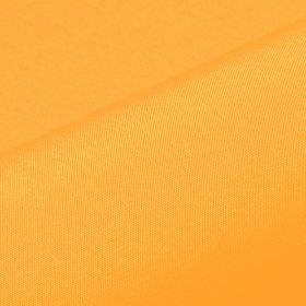 Banda - Orange (1) - Bright, light pumpkin orange coloured fabric made from 100% Trevira CS with no pattern