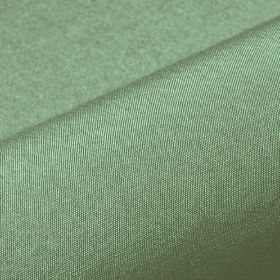 Banda - Green (13) - Fabric made from 100% Trevira CS in a light shade of green with a very subtle light grey tinge