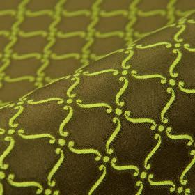 Triennale - Green Brown - Very dark brown and bright lime green coloured 100% Trevira CS fabric featuring a small, repeated scroll and dot p