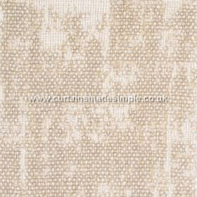 Jarapa - 06 - A partial caramel coloured bouclé effect revealing fabric made from linen, jute and cotton in a an off-white beneath