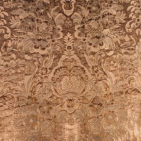 Kapurthala - Maharaja - Copper coloured fabric which has a busy, ornate, textured pattern in the same colour