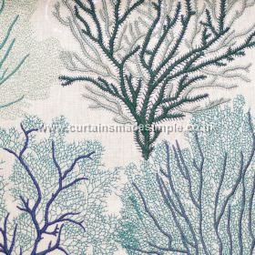 Corail - 04 - Silver, dark green and two shades of blue making up an embroidered tree design on white fabric which has been blended