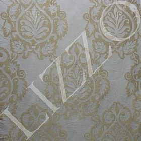 Bator - Nomad - Ornate gold-beige designs over a silver-grey coloured viscose-polyester-linen blend fabric background