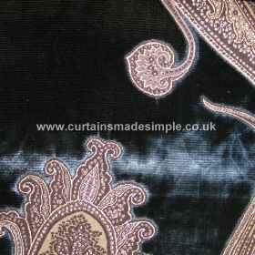 Rigoletto - 04 - Slightly patchy, textured, very dark blue coloured viscose fabric with an intricate brown and caramel coloured pattern