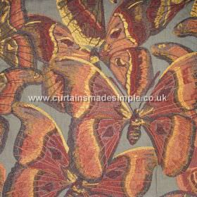 Butterfly - 08 - Iron grey viscose-linen blend fabric covered in large, overlapping butterflies in warm red, orange and yellow tones