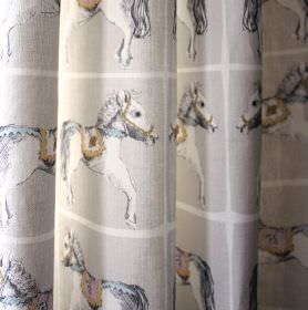 Horsey - Grey Pink-Turquoise - Folds of 100% cotton fabric with rows of pale white, gold and blue merry-go-round horses in light grey colour