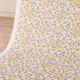 Bud - Lemon Slice - Light shades of yellow and grey making up simple leaves and circular, stylised flowers on white cotton and linen blend fbaric