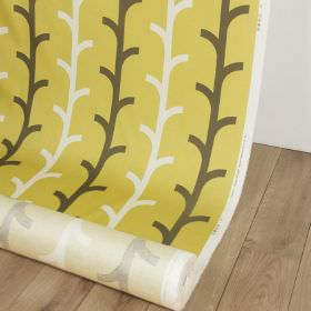 Beanstalk - Apple - Simple, stylised branch designs printed in white and dark brown-grey on green-yellow fabric made from cotton and linen