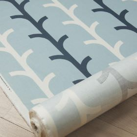 Beanstalk - Misty Blue - Fabric made from cotton and linen with a simple, stylised branch pattern in white, baby blue and deep navy blue