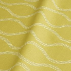 Drift - Apple - Light butter yellow coloured fabric made from cotton and linen, featuring a wavy line pattern made up of tiny white dots