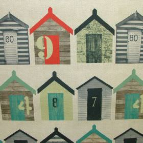 Rustic Beach Huts - Photo Digital - Numbered beach huts in shades of grey and green with some red highlights on a cream-grey cotton fabric b