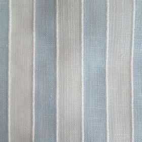 Bengala - Blue - Slightly raised white lines running between a vertical stripe design on fabric in light shades of grey and blue