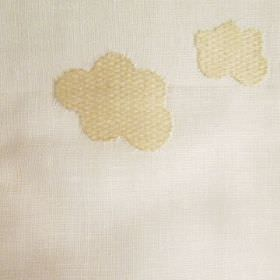 Clouds - Beige - Straw coloured cloud shapes making up an irregular, slightly raised, textured, patterned design on beige fabric