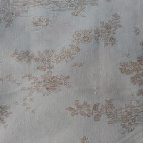 Agustina - Beige - Pretty beige floral patterns scattered over a background of plain white 100% cotton fabric