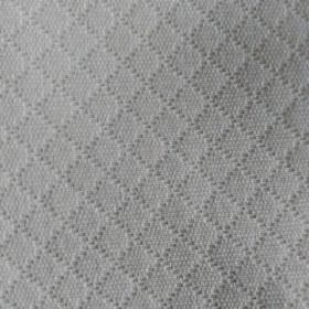 Lucas - White - Subtly embossed dots making up a soft grid pattern on fabric made from cotton and polyester in very pale grey-white