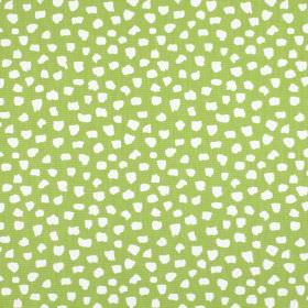 Dita - Eucalyptus - Fabric made from apple green coloured 100% cotton which has been scattered with small, random white shapes