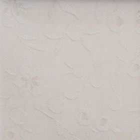 Isla - Putty - Cotton fabric with a subtle, raised pattern of flowers in off-white