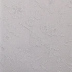 Isla - Sterling - Fabric made from very pale grey cotton, with a pattern of simple flowers which is raised
