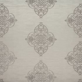 Catherine - Dusk - An ornate design made up of swirling grey lines over a putty coloured 100% polyester fabric background