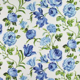 Portia - Indigo - Cotton fabric in white as a background for large flowers shaded in blue, with green leaves which are realistic