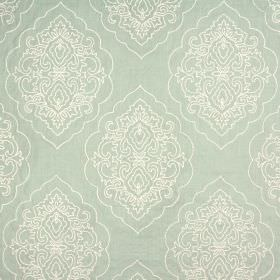 Brocade - Peppermint - Ornate white curves and lines embroidered repeatedly on pale green coloured fabric made from 100% cotton