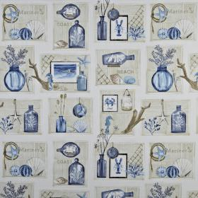 Beachcomber - Periwinkle - Shades of blue and grey making up a coral, shell, vase, bottle and picture print on beach themed 100% cotton fabr