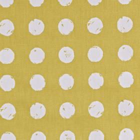 Zero - Saffron - 100% cotton fabric in a golden honey colour, behind a roughly printed polka dot pattern in white