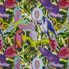 Martinique - Jungle - A purple parrot printed with pink strawberries on a busy background in different shades of green which is made of cott