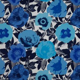 Madone - Azure - Pop art style poppies printed in different shades of blue against a patterned navy blue and white cotton fabric background