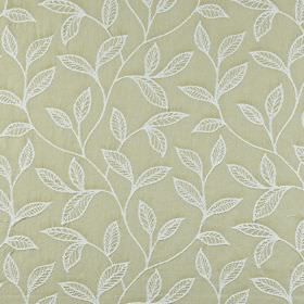Ferndown - Lichen - Embroidered 100% cotton fabric featuring an elegant white leaf design on a light beige background