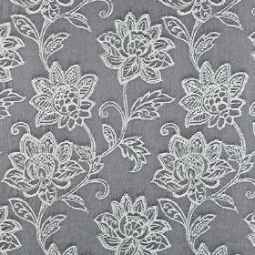 Wimborne - Denim - Battleship grey coloured 100% cotton fabric behind an embroidered design of ornate white florals