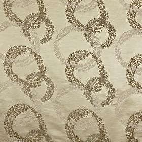 Exposure - Oyster - Lustrous light grey-beige 100% polyester behind a design in various brown and beige shades of dotted, interlocking circles