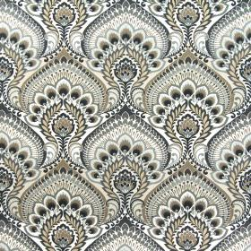 Nikita - Tabacco - White cotton fabric behind large, ornate, repeated designs in colours such as grey and a straw-like shade of beige