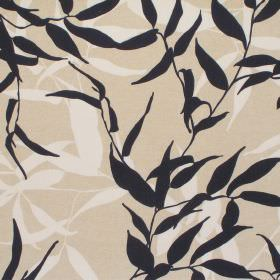 Tropic - Onyx - Cotton fabric in cream, covered in silhouettes of tangled leaves in black and white