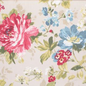 Luciano - Pomegranate - Red and blue flowers making a large pattern with green leaves on cream coloured fabric made from cotton