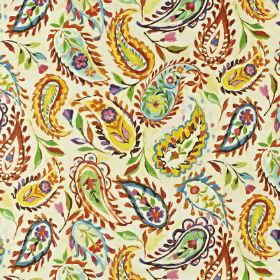Calypso - Tropical - Bright multicoloured floral paisley style patternsin yellow, blue, red, purple and green on linen and cotton blend fabri